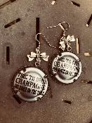<b>LES PÉTILLANTES</b><br /><b>BOUCLES D'OREILLES CAPSULE</b><br />Time to drink Champagne and dance<br />